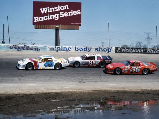 Rich Bickle (45) leads Dick Tricke (99) and Joe Shear through at Rockford (Ill.) Speedway