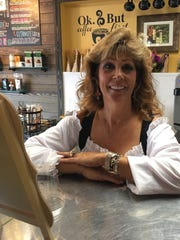 Valerie Steinbeck owns The Knotty Bean on Fort Myers Beach. She's dressed for Pirate Fest on the beach.