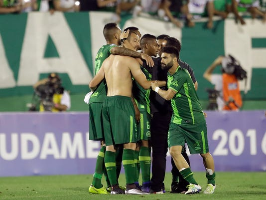 FILE - In this Wednesday, Nov. 23, 2016, file photo, players of Brazil's Chapecoense celebrate at the end of a Copa Sudamericana semifinal soccer match against Argentina's San Lorenzo in Chapeco, Brazil. A chartered aircraft with 81 people on board, including the Brazilian first division Chapecoense soccer team heading to Colombia for a regional tournament final, has crashed on its way to Medellin's international airport. (AP Photo/Andre Penner, File)