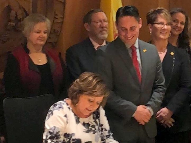 Senator Howie Morales smiles while watching Governor