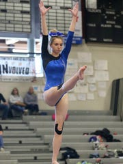 Performing on balance beam during regionals March 3