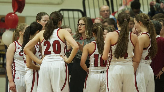 CVU head coach Ute Otley talks to the team during the girls basketball game between Spaulding and Champlain Valley Union at CVU high school on Thursday night.