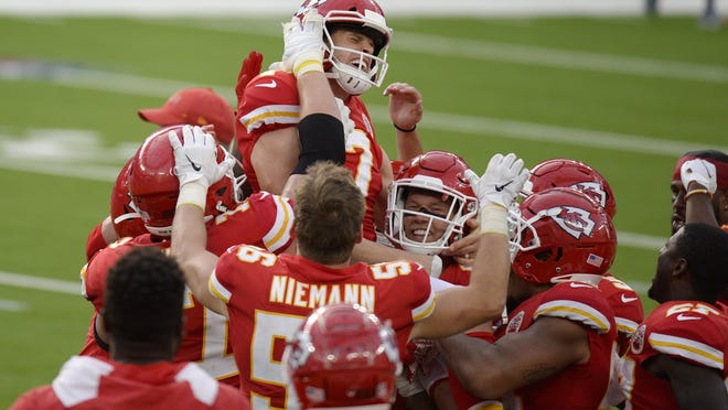 Chiefs kicker Harrison Butker is lifted by teammates after making the game-winning field goal Sunday in Inglewood, Calif.