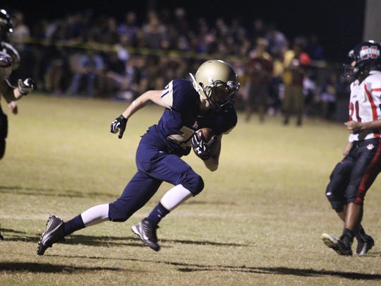 Pope John Paul II's Aidan Murtha sprints toward the end zone in a game against Munroe High.