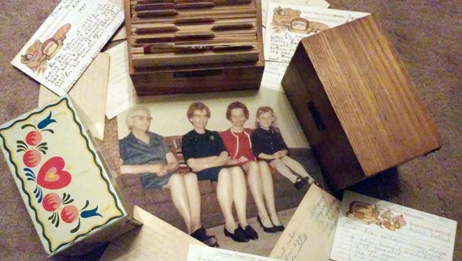 Kristine Dietrich (far right, in snapshot) has recipe boxes from her mother, grandmother and great-grandmother.