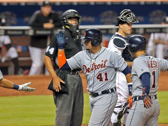 Victor Martinez is greeted by Ian Kinsler and Jose Iglesias after a second pinch-hit homer in two days.