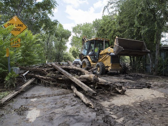 Yavapai County workers clean up the damage from a flood