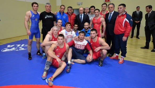 President Putin, Sports Minister Vitaly Mutko and athletes.
