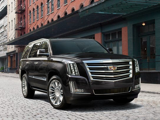 which is better lincoln navigator and cadillac escalade compared. Black Bedroom Furniture Sets. Home Design Ideas