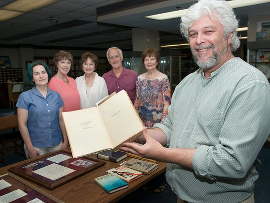 """The book in the photo is Earnest Hemingway's """"A Farewell to Arms"""", signed and numbered by Hemingway.  The book is the 385th out of 500 printed.  New York, Charles Scribner's Sons, 1929.Smith Collection/Archives"""