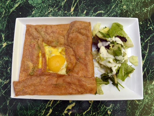 Blue Moon restaurant also offers breakfast, lunch and dinner crepes. The complete crepe is filled with a sunny side egg, avocado, ham and melted Monterey Jack cheese and comes with a side salad.