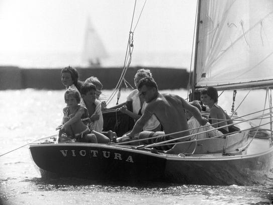 Robert Kennedy at the helm of the family sailboat,