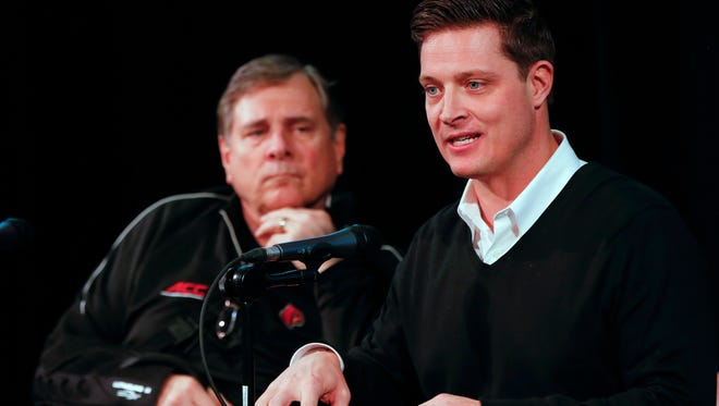 Former athletic director Tom Jurich, left, and his son, Mark Jurich, who was the former associate athletic director.    Feb. 4, 2016