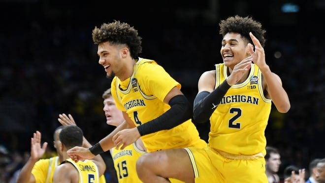 Forward Isaiah Livers, left, and guard Jordan Poole will likely open the 2018-19 season in Michigan's starting lineup.