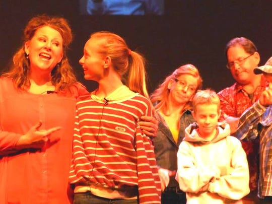 "VOICES cast members, Stacy Hambrick, left, sings ""Brave"""