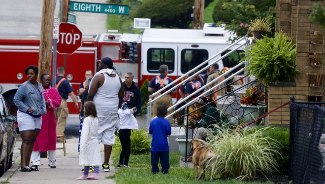 Residents evacuate an apartment complex at W. Eighth Street and Hermosa Avenue in West Price Hill after a morning fire.