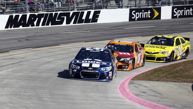 Jimmie Johnson (48) leads Kyle Busch (18) and Matt Kenseth (20) during Sunday's Goody's Fast Relief 500 at Martinsville Speedway.