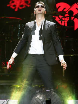 Robin Thicke performs during Y 100 Jingle Ball at BB&T Center on December 20, 2013 in Sunrise, Fla.