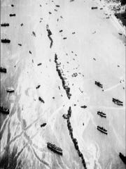 UTAH BEACH, FRANCE:  Aerial view taken from a B-26 in June 1944 showing Liberty Ships, 32 American merchant ships which were purposefully sunk off the coast of Normandy to support Allied forces. With Army gunners onboard, ships served as both a breakwater and an offshore anti-aircraft gun platforms to protect Allied forces after Allied forces stormed the Normandy beaches on D-Day. D-Day, 06 June 1944 is still one of the world's most gut-wrenching and consequential battles, as the Allied landing in Normandy led to the liberation of France which marked the turning point in the Western theater of World War II.