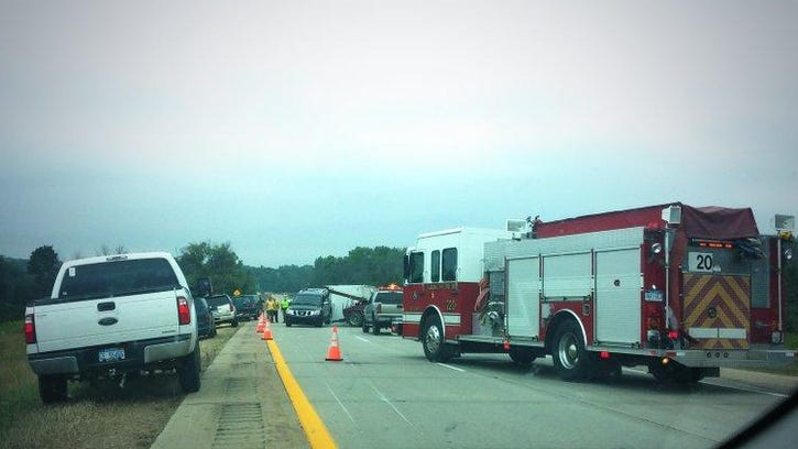 U.S. 131 was closed at 10 Mile Road for an SUV pulling a camper that flipped.