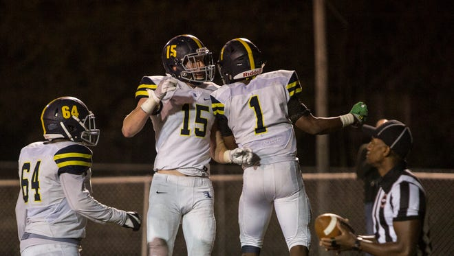 September 08, 2017 - Lausanne's Eric Gray, 1, celebrates with teammates after running in for a touchdown during Friday night's game at Whitehaven High School. Lausanne topped Whitehaven 14-7.