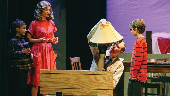 """The Actors' Repertory Theatre of Simi's production of """"A Christmas Story: The Musical"""" runs through Dec. 23 at the Simi Valley Cultural Arts Center. Actors, from left, are Lucas Panczel as Randy, Megan Ruble as Mother, Kevin Ellis as The Old Man and Patrick Geringer as Ralphie."""