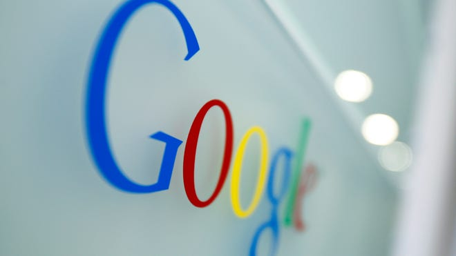 In This March 23, 2010, file photo, the Google logo is seen at the Google headquarters in Brussels. Google has bought Titan Aerospace, a maker of solar-powered drones, the company announced Monday, April 14, 2014.