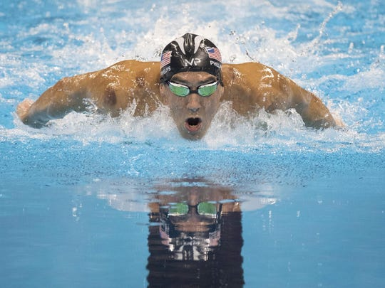 U.S. swimmer Michael Phelps swims on Aug. 9 to a gold medal in the men's 200 meter Butterfly at the Olympic Aquatic Stadium in Rio de Janeiro, Brazil.