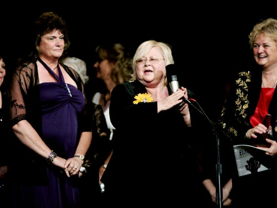 Dixie Hall, center at the microphone, accepts the award for Best Recorded Event with other members of the Daughter of Bluegrass at the International Bluegrass Music Association Awards show Oct. 1, 2009.