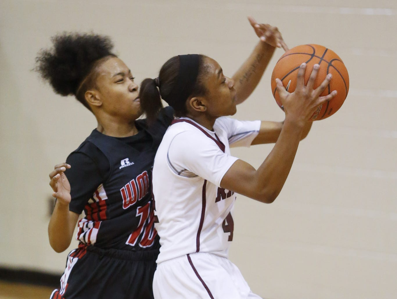 Concord's Aahliyah Selby drives to the basket in front of William Penn's AlizeFelton in Concord's 50-34 win Thursday.