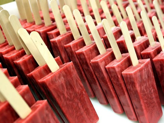 Cherry-lime popsicles ready for packaging at MemPops on Ridgeway. The shop uses fresh fruit to make its pops