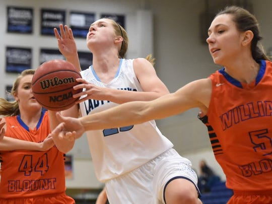 Hardin Valley's Abbey Cornelius (25) drives past William Blount's Maggie Bell (44) and Lindsey Roddy (5) during a high school basketball game at Hardin Valley Academy on Thursday, Jan. 7, 2016.