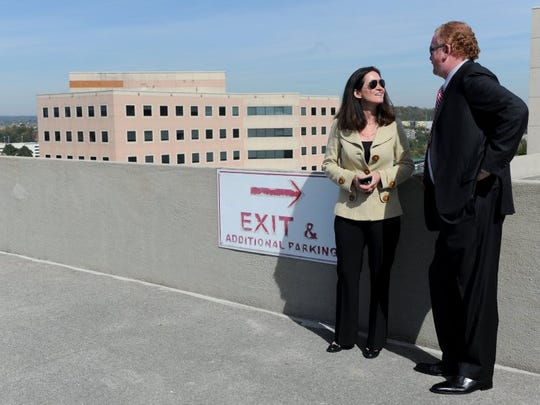 Regal Entertainment executives Amy Miles and Greg Dunn speak while overlooking a view of downtown Knoxville before the announcement of a multimillion-dollar deal to move Halls-based Regal Entertainment, the nation's largest movie theater chain, to a vacant medical office building on the South Waterfront along Friday, Oct. 23, 2015. (JESSICA TEZAK/NEWS SENTINEL)