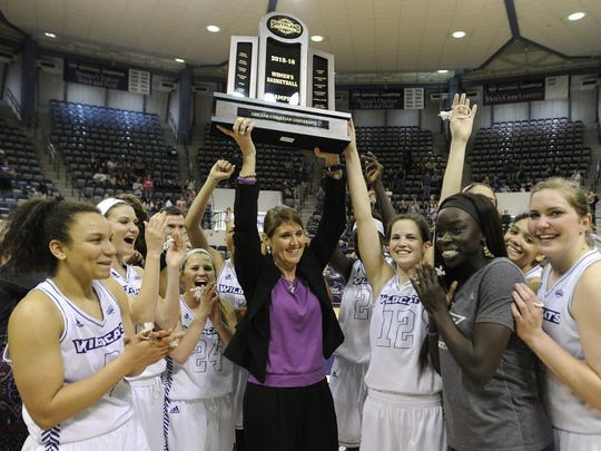 ACU coach Julie Goodenough and her players celebrate with the Southland Conference championship trophy off the court after the Wildcats' 63-52 win over Texas A&M-Corpus Christi on March 5, 2016, at ACU's Moody Coliseum. The win clinched ACU's first Southland Conference regular-season title.