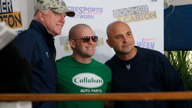 Boomer Esiason and Craig Carton of WFAN's Boomer & Carton pose with a fan at The Headliner in Neptune, NJ on Friday, May 22.
