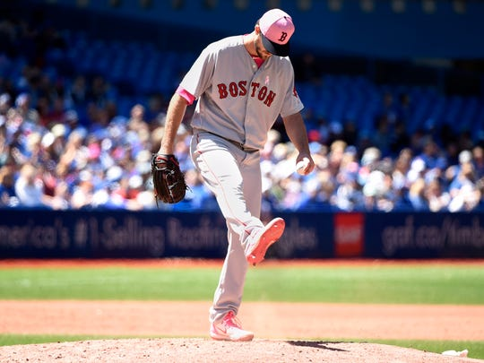 Boston Red Sox starting pitcher Drew Pomeranz (31) kicks dirt after being called for a balk during third inning action against the Toronto Blue Jays in Toronto on Sunday, May 13, 2018. (Nathan Denette/The Canadian Press via AP)