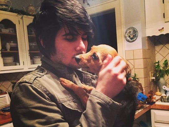 Anthony Leyva, seen here with his puppy, Olive, is