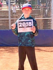 Logan Sandoval won in Boys 11-12 Running and for 12 and under in the Junior Homerun Derby.