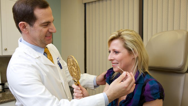 Dr. Ross Clevens has a consultation with a patient who is considering plastic surgery.