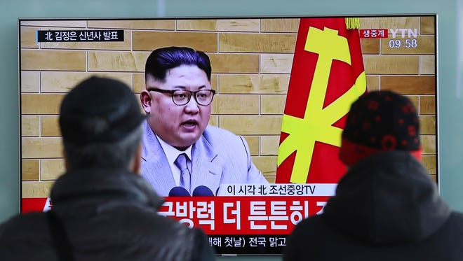 South Koreans watch a TV news program showing North Korean leader Kim Jong Un's New Year's speech, at the Seoul Railway Station in Seoul, South Korea, Monday, Jan. 1, 2018.