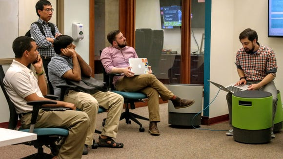 Members of Open Data Delaware work through a problem during one of the group's monthly Hack Nights.