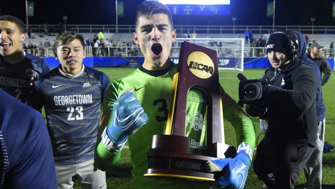Georgetown goalkeeper Tomas Romero celebrates with the championship trophy after defeating Virginia for the 2019 NCAA championship at WakeMed Soccer Park in Cary, N.C. Austin FC officials have put in a bid to host the College Cup starting in 2022.