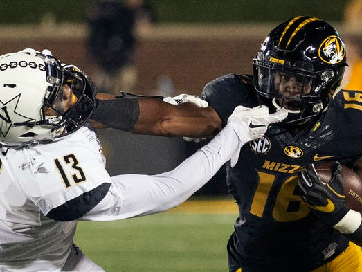 Missouri running back Damarea Crockett, right, grapples