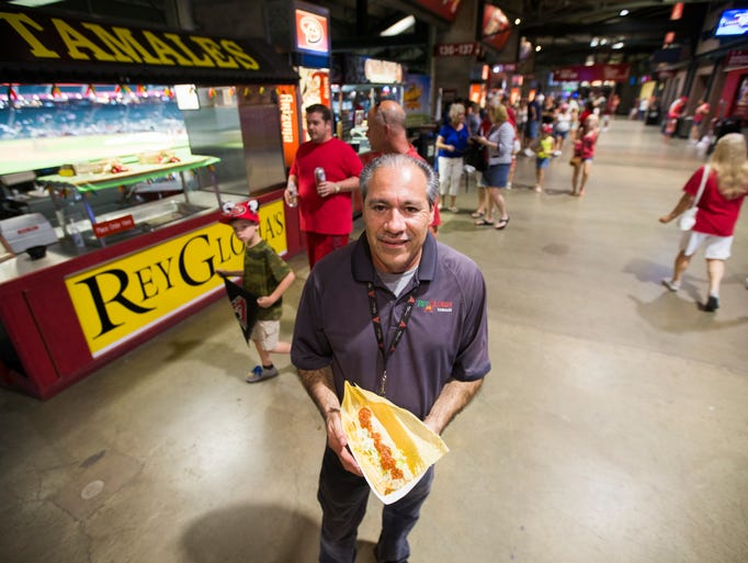 Rey Cota holds tamales he sells at Chase Field. Rey Gloria's can be found on the main concourse near the third base foul pole.