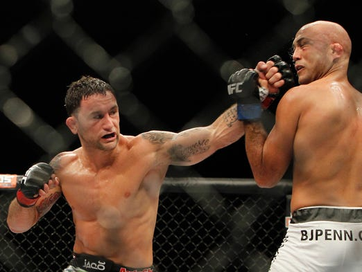 Frankie Edgar (left) fights B.J. Penn during Sunday's UFC bout in Las Vegas.