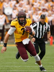 Minnesota quarterback Mitch Leidner (7) runs down the