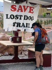 Hiker Leticia Luna arrives at the Lost Dog Trailhead, which had a sign attached to a rest area in July 2018. Luna hikes the trails at least once per week.