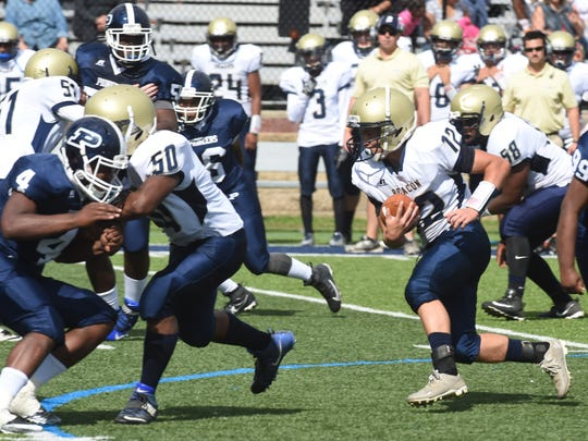 Beacon's William Rivera, right, looks for an opening during a Sept. 2017 game against Poughkeepsie.
