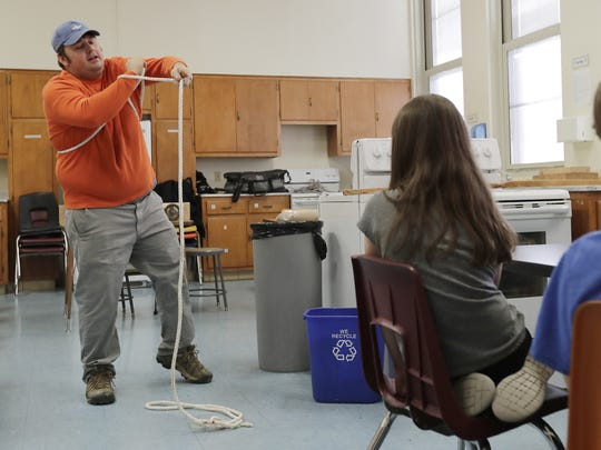 Mark Hawkins demonstrates knot tying in an after school class at Aldo Leopold Community School in Green Bay. Hawkins started the nonprofit Hands On Deck in 2016 for children and adults to learn boatbuilding and boating skills.