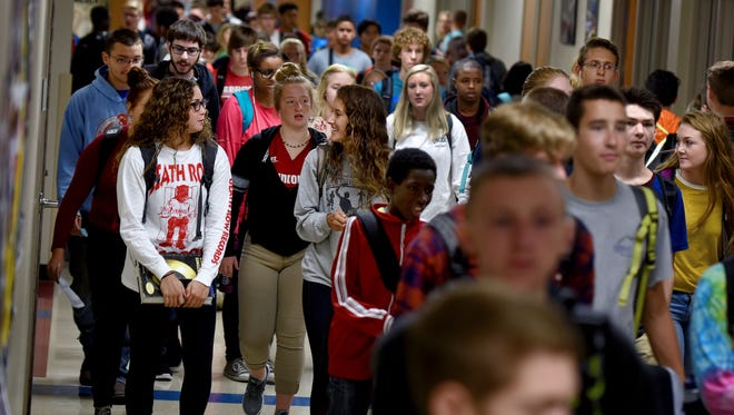Students walk the halls in-between classes at Lincoln High School.